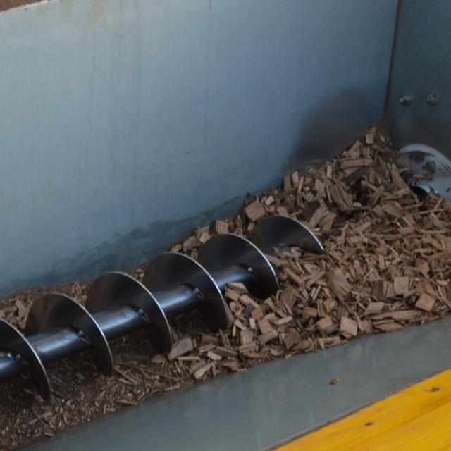 Wood chips conveyor screw